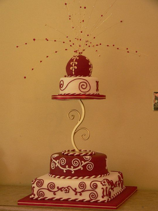 This cake puts a cultural twist on the classic wedding cake as it was created for an Indian wedding. The bead spray is the only inedible thing.