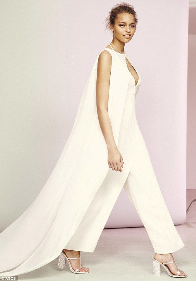 cd16c9cca27 Styles to suit all brides  One of the bridal jumpsuits is detailed with a  unique cape that glides behind the bride like a traditional veil (pictured)