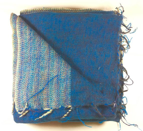 This beautiful, authentic Yak wool blanket was hand-loomed in Kathmandu, Nepal. It is a deep sea blue mixed with black throughout. It has a