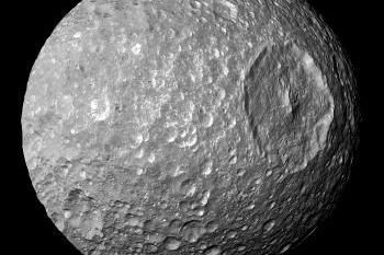 Scientists say a subterranean ocean beneath Mimas' icy surface would explain the Saturn moon's strange, wobbling rotation.