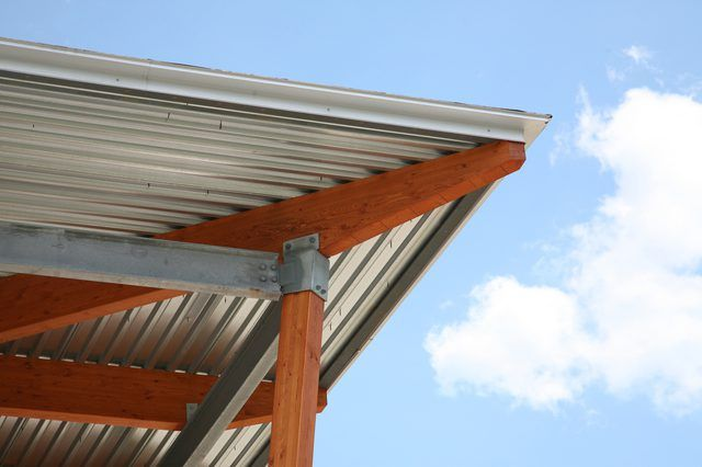 How To Install Corrugated Roof Panels Under A Deck Hunker Roof Panels Metal Roof Steel Roofing