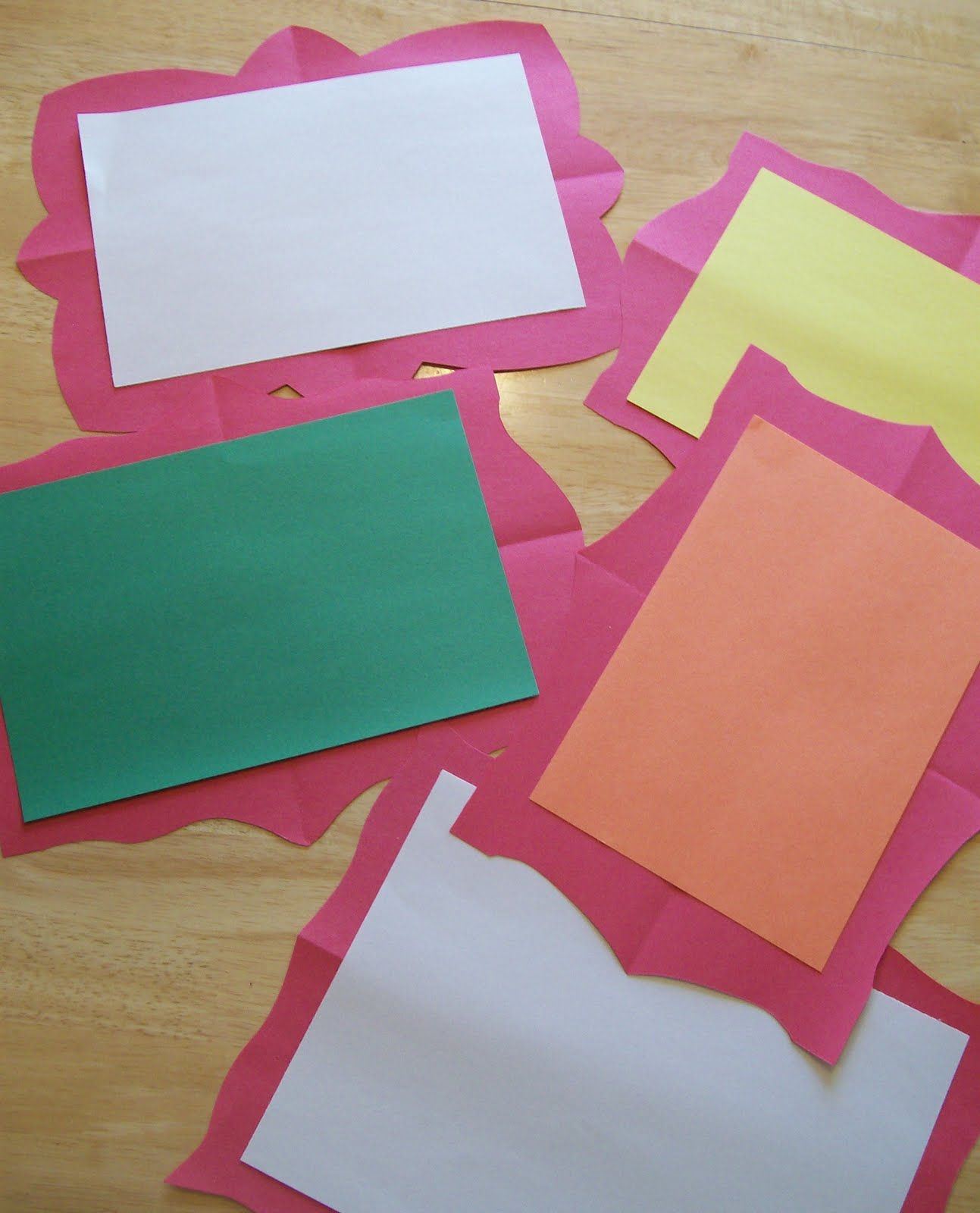 Symmetrical paper frames for children's art...fold construction paper in fourths and cut a fancy edge.