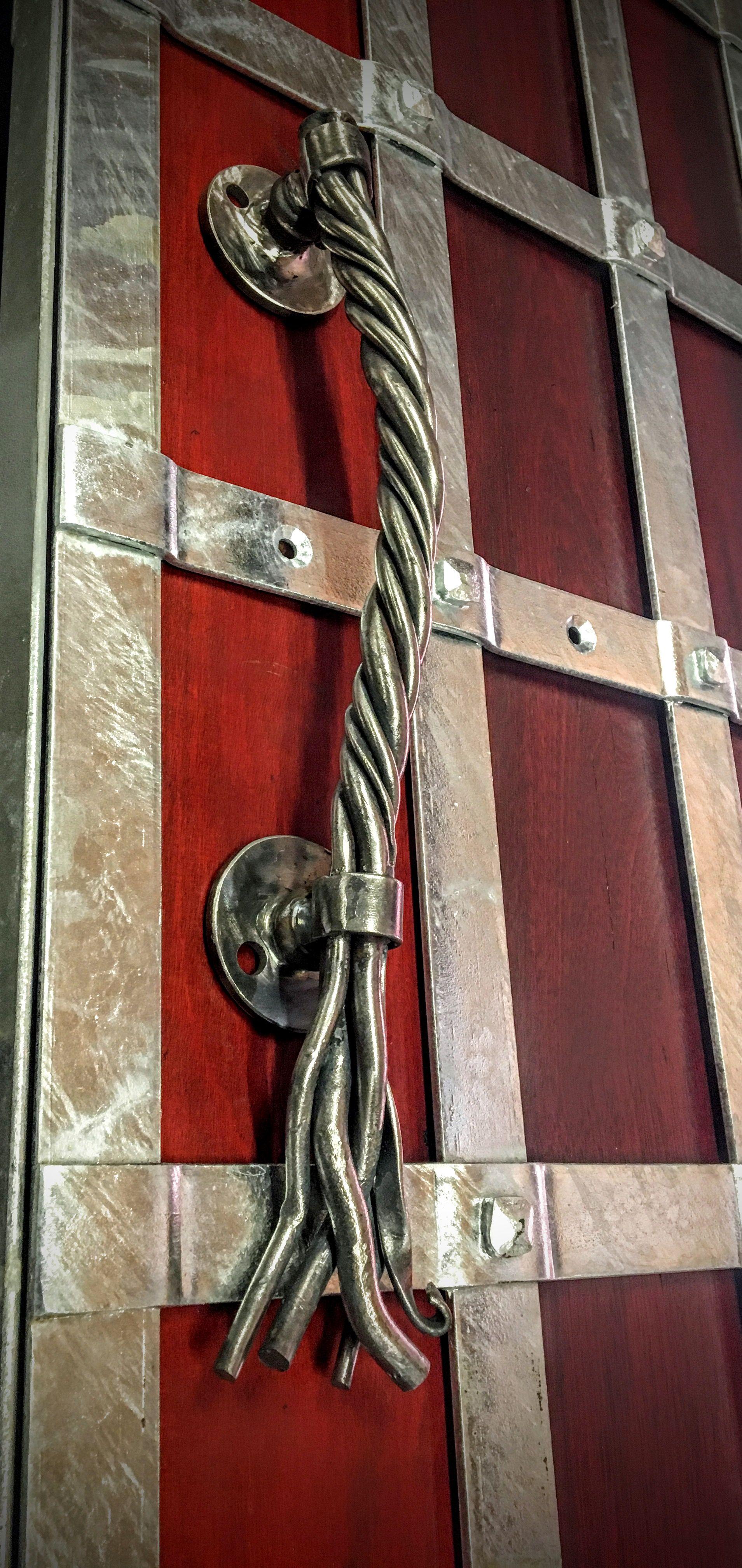 Custom made wrought iron door handle statement entrances