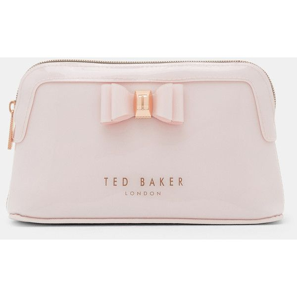 Bow detail wash bag ($35) ❤ liked on Polyvore featuring beauty products, beauty accessories, bags & cases, dusky pink, make up purse, ted baker makeup bag, toiletry kits, toiletry bag and cosmetic purse