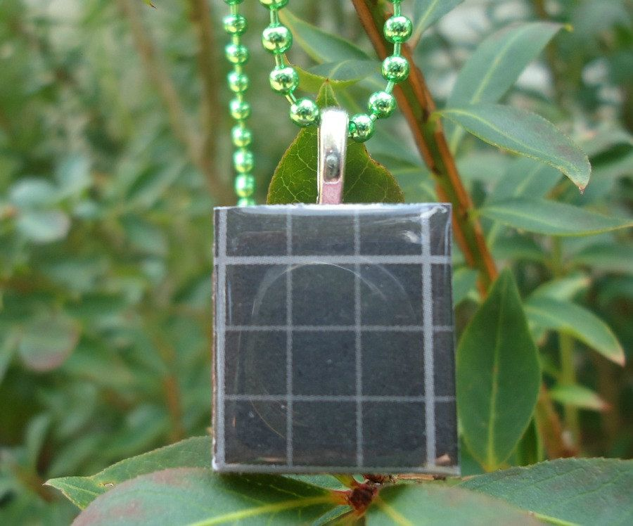 Black Plaid: A pendant charm necklace made from a dark red Scrabble (c) tile. $6.50, via Etsy.
