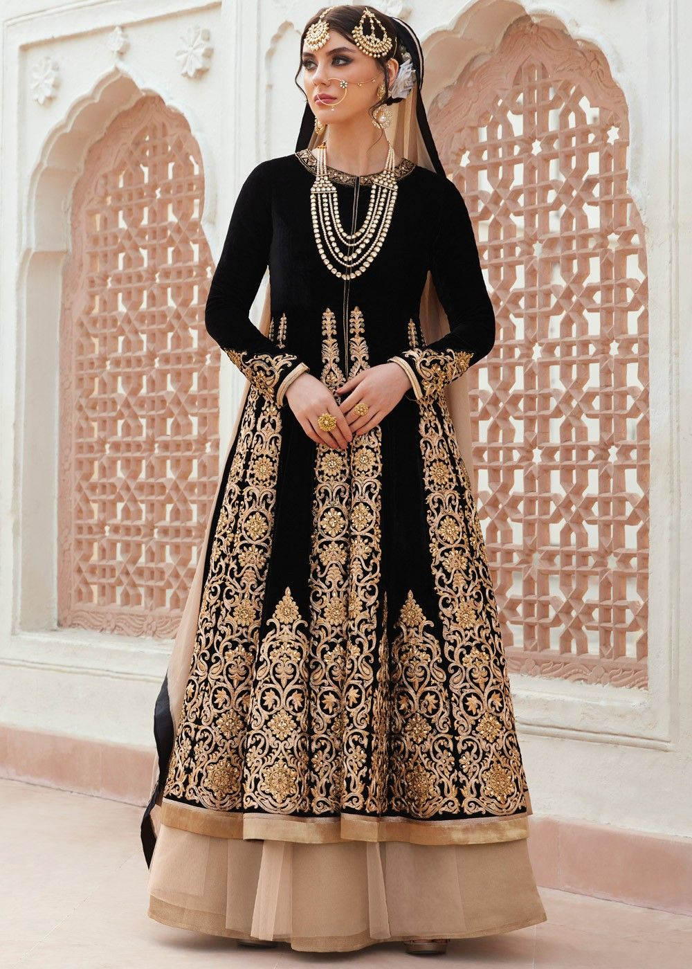 9a830456d1 Look marvellous in this #black #velvet #kurti style long #choli decked with  zari embroidery, lace and stone work.
