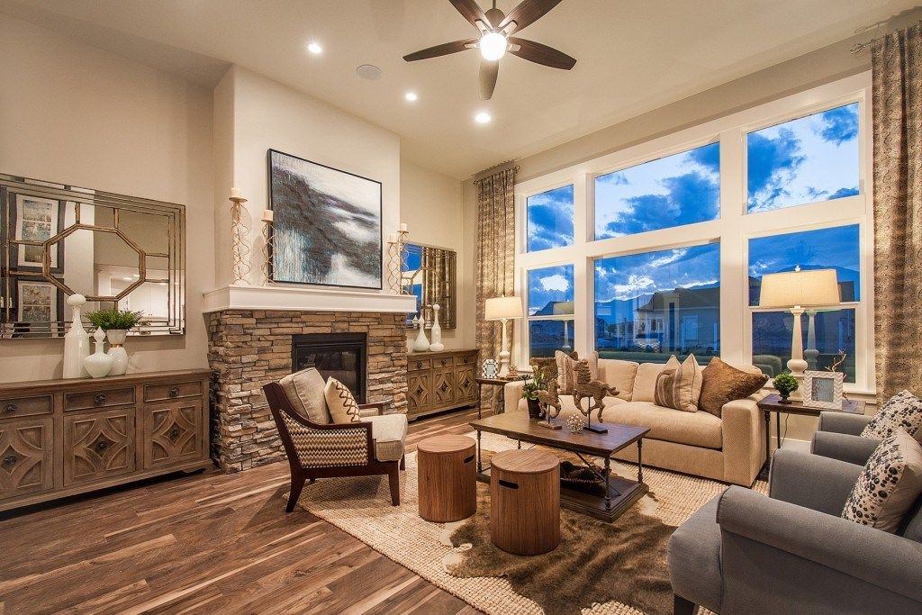 A Stacked Stone Fireplace And Expansive Windows Define This Great Room. A  New Home