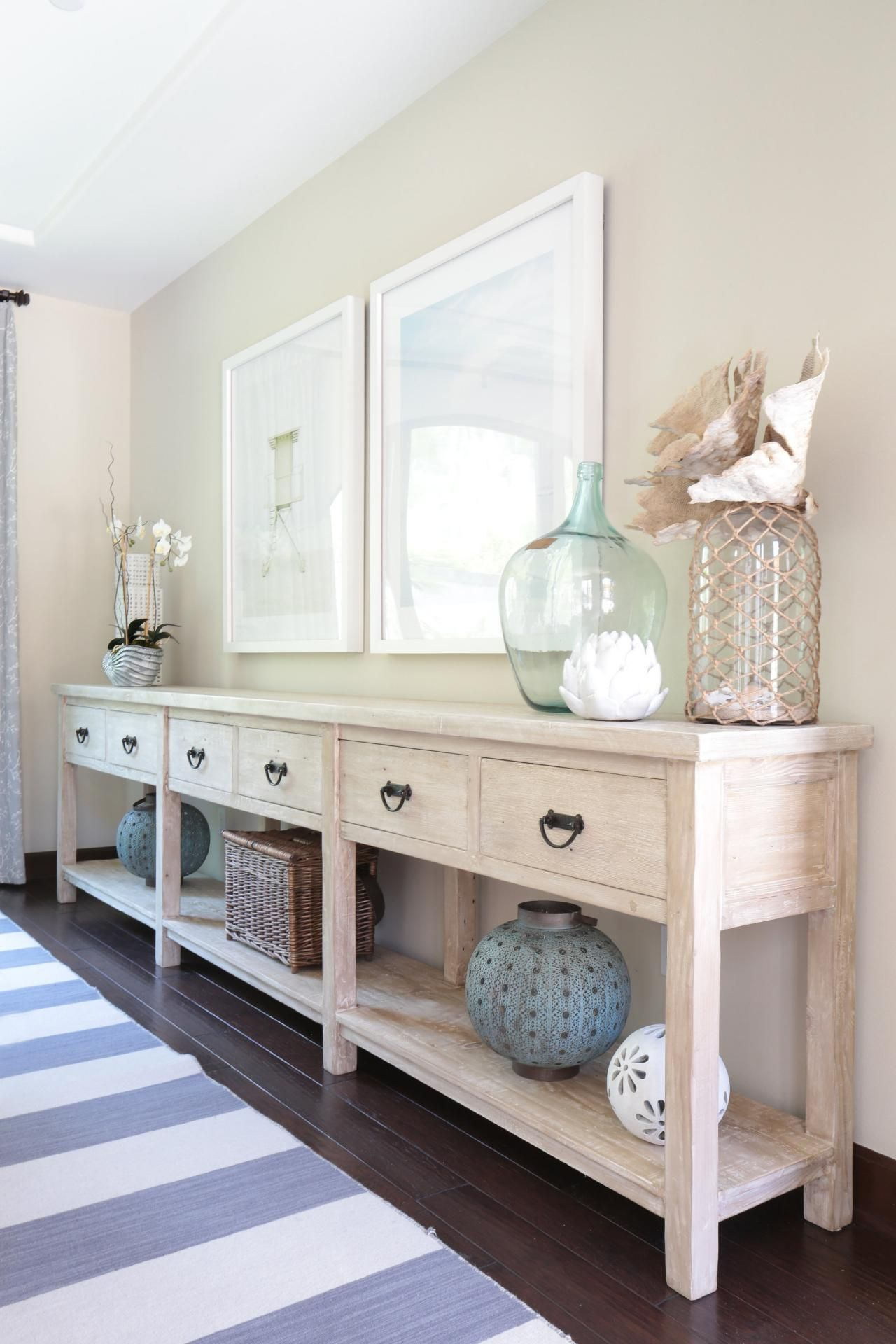 HGTV features a transitional coastal neutral dining room with a