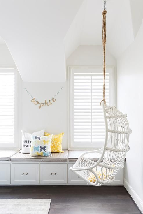 White cottage teen girl's bedroom features a white rattan ...