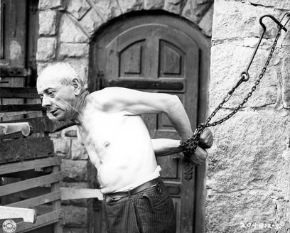 Mauthausen, Austria, December 1945, A political prisoner demonstrating the way the prisoners were tied.