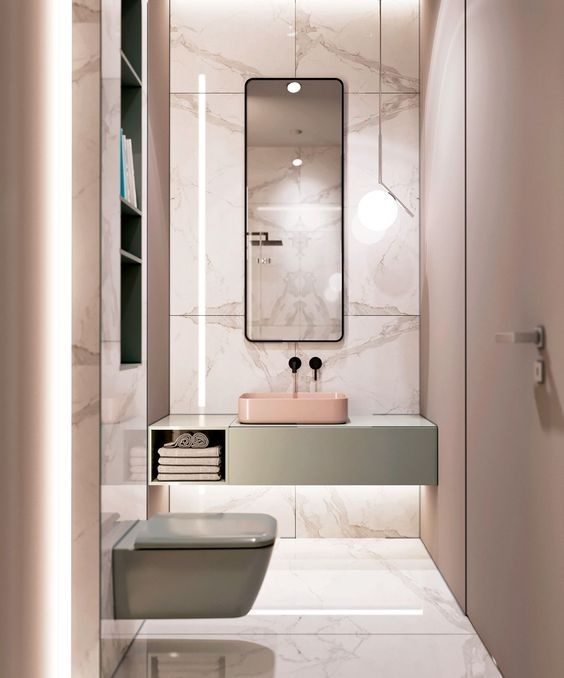 In un bagno rosa contestualizza anche degli oggetti o rubinetterie nere o  grigio scuro. Come