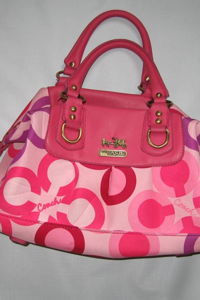 Up for sale preowned in very good condition Pink Coach