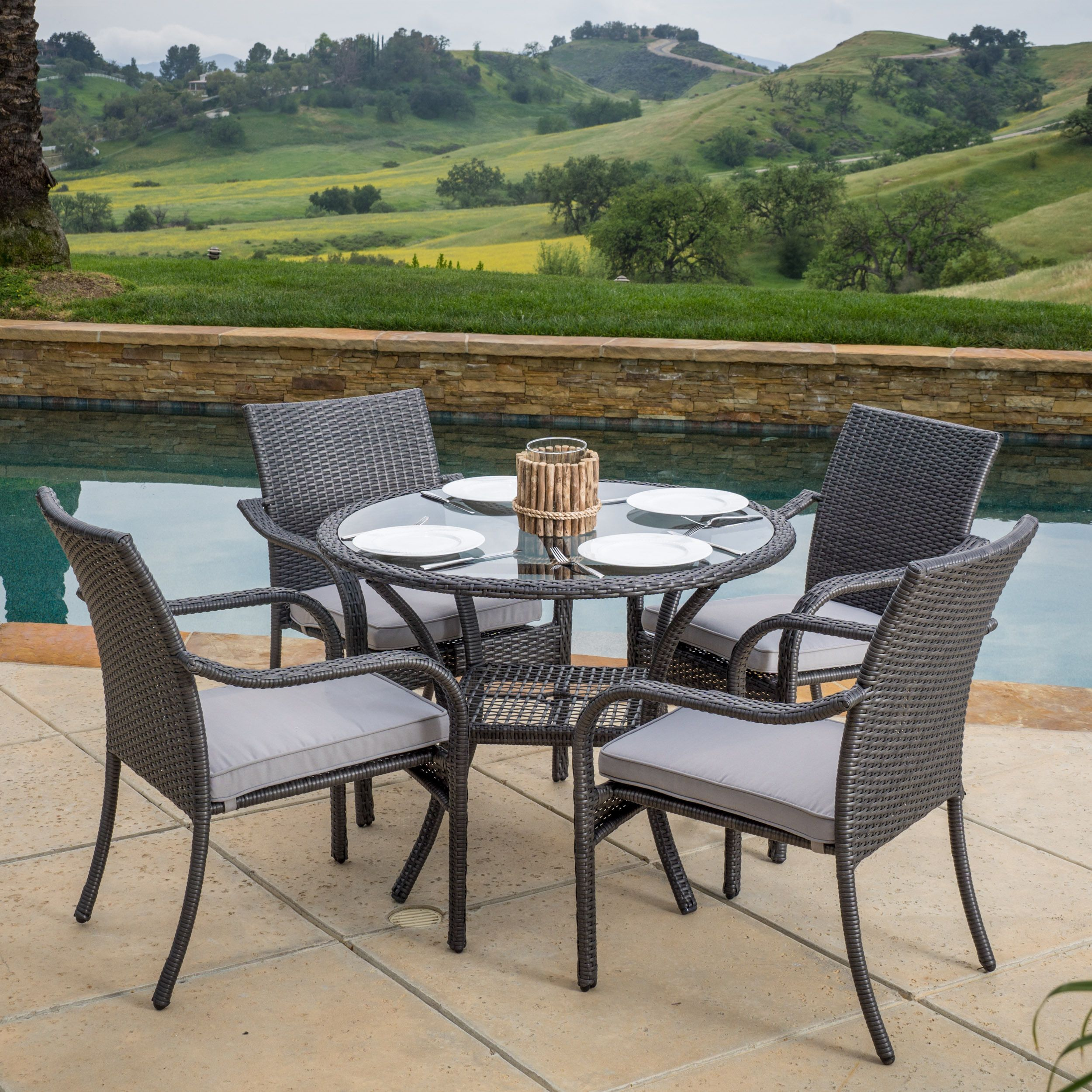 This set offers a solid foundation of metal and resin wicker juxtaposed with a sleek fabric to create a combination look that is not only trendy but