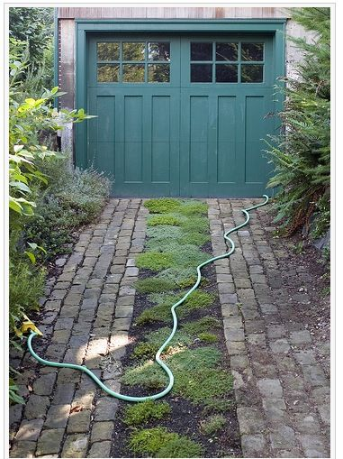I Simply Love This Garage Door Pavers Too The Whole Thing Looks So Pretty To Me Permeable Driveway Brick Driveway Grass Driveway
