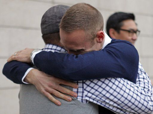 Bernie Liang and Ryan Hamachek embrace after getting married outside Seattle City Hall.     Such a beautiful and emotional photo. Congrats Ryan! You were the best leadershape cluster leader I had :)