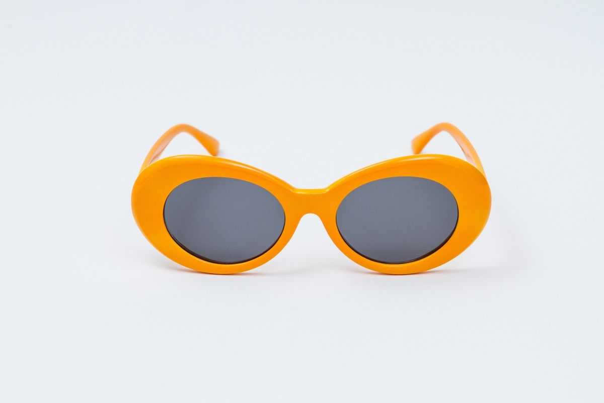 ⚫ T. Chang are handmade oval frame acetate sunglasses. ⚫ Orange acetate frame with black lenses ⚫ 100% UV protection ⚫ Nose pads in frame ⚫ 100%...