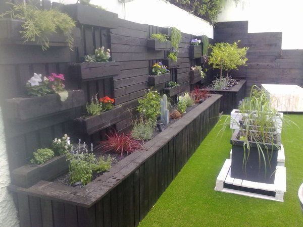 Terrace / garden with recycled wood construction by ...