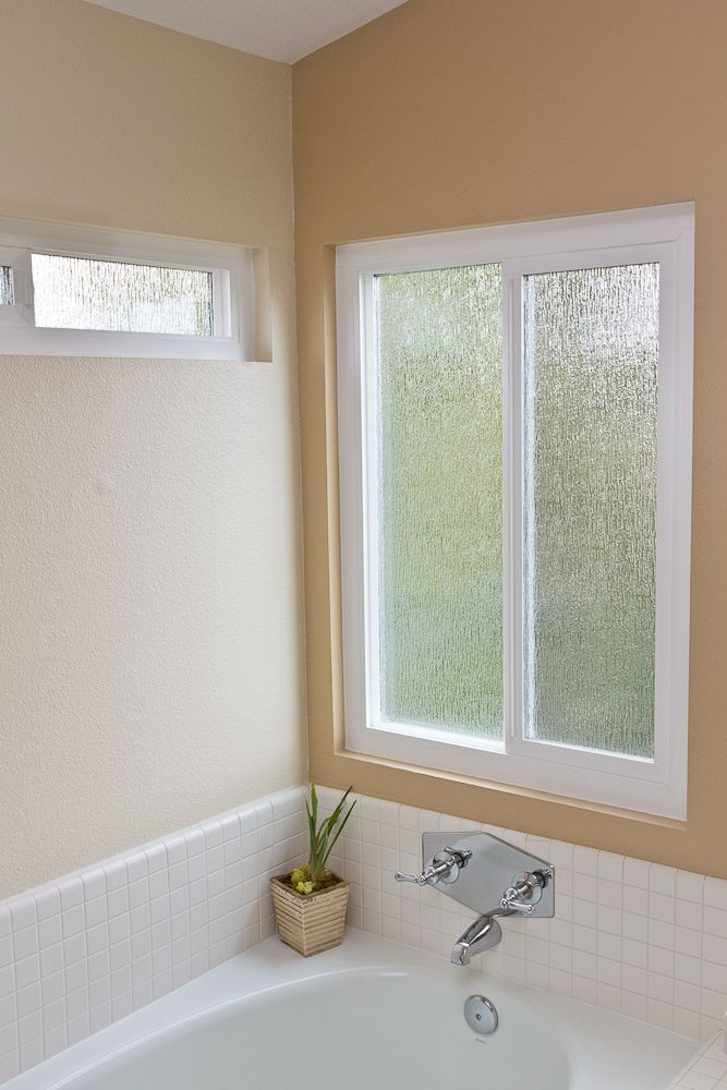 Bathroom Window Repair rain patterned obscure privacy glass compliments and enhances this