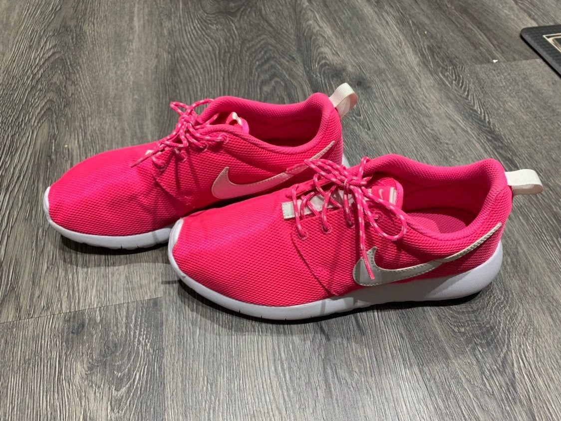 Pink and white Nike running shoes