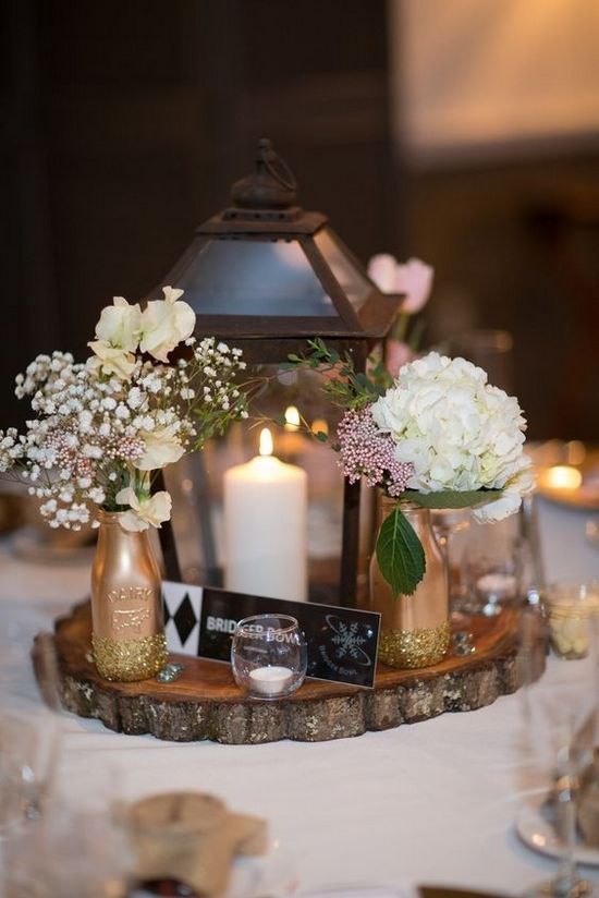 Rustic lantern and tree trunk centerpieces http