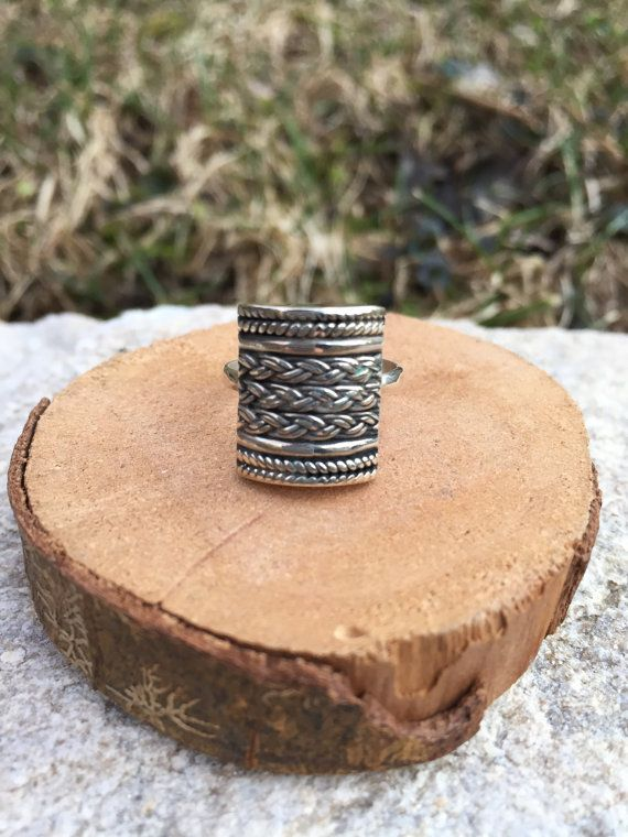 This gorgeous ring was handcrafted using a vintage, multi-patterned barrel shape and a sterling silver band. I wanted to find a simple way to show