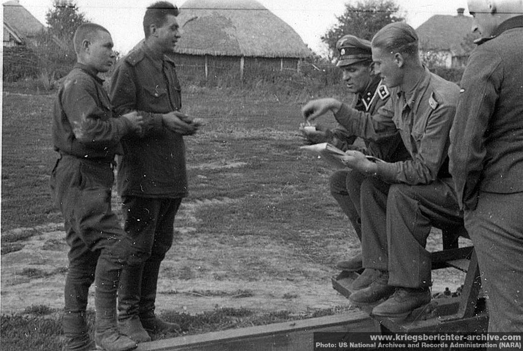 """""""Relaxed"""" interrogation of Soviet POWs by Waffen SS officers. A surprising number of German officers spoke passable Russian given the close German-Soviet military training cooperation during the interwar years. They all had their hands full once Hitler invaded Russia."""