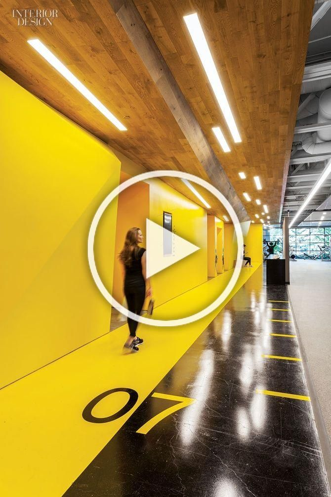 Gensler San Jose's Fitness Center for Symantec | Numbers are stenciled on the main corridor's polish...