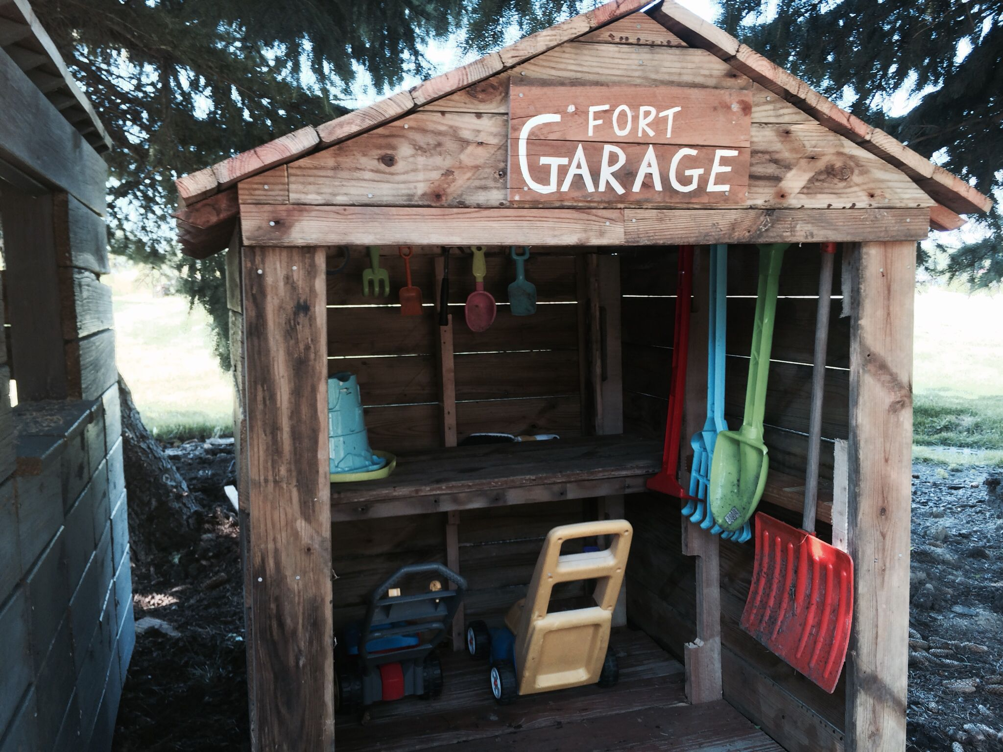 Old decking reclaimed wood fort garage kids playhouse for Wooden playhouse with garage