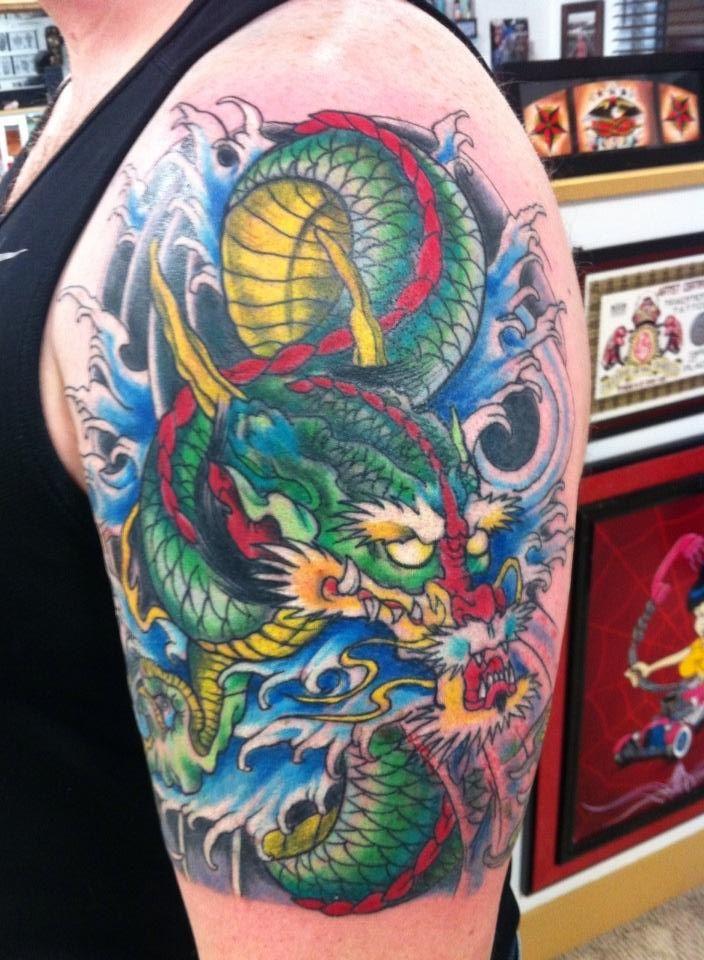 Color Dragon Tattoo By Rick Aggro Tattoopics Org Dragon Tattoo Color Tattoo Tattoos