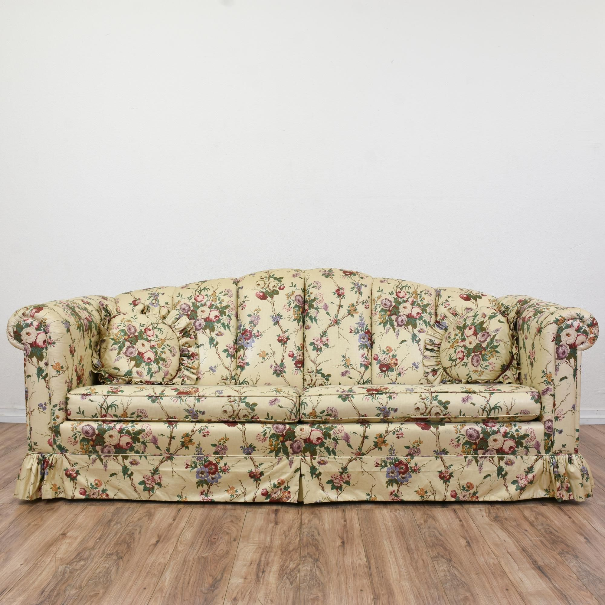 This sofa is upholstered in a durable off white beige pink and
