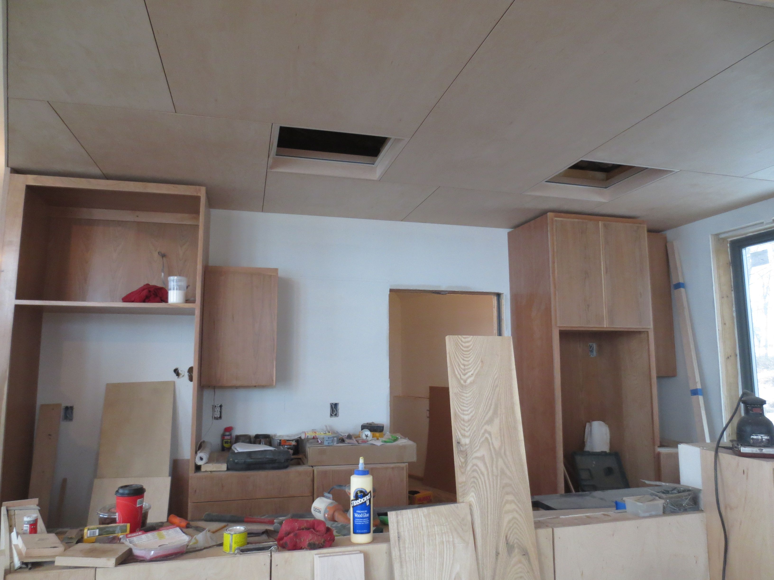 Kitchen cabinets partly in.