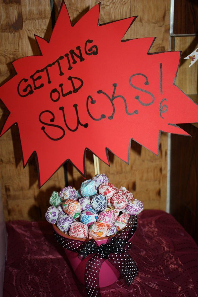 Getting Old Sucks! Lollipop table centerpiece that I put together