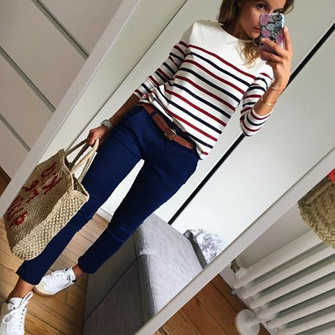 Striped sweater with casual pants and white tennis shoes