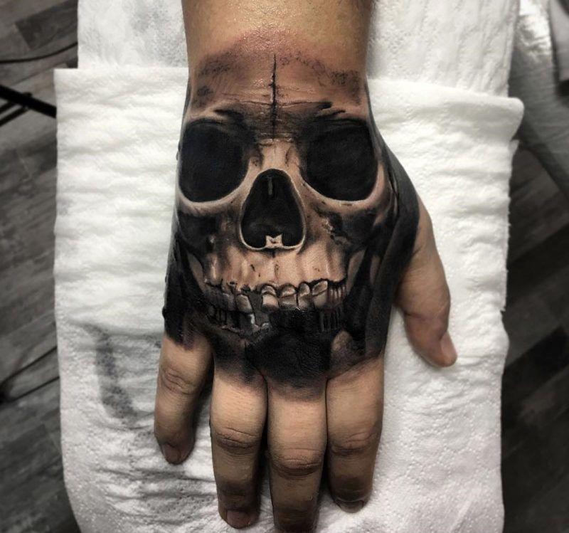 Realism Skull Hand Tattoo Hand Tattoos For Guys Skull Hand