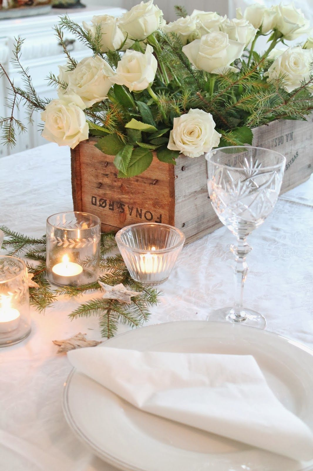 Love the box with roses in... rustic and elegant together - have each centerpiece be different!