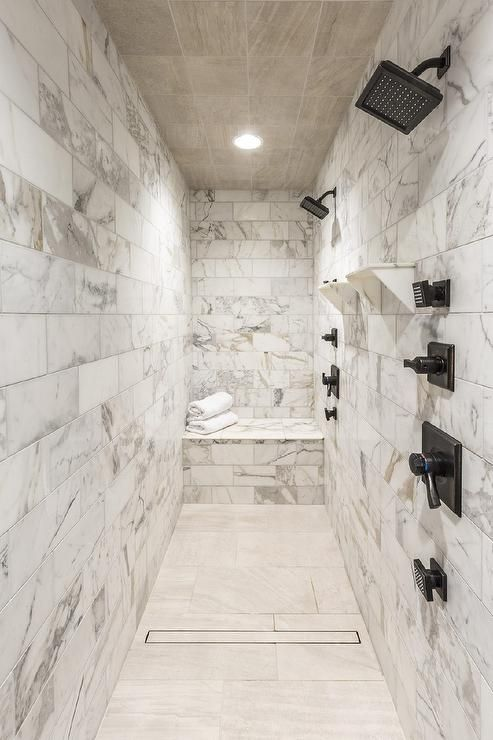 Long Marble Clad Shower Features A Wood Like Tiled Grid Cieling