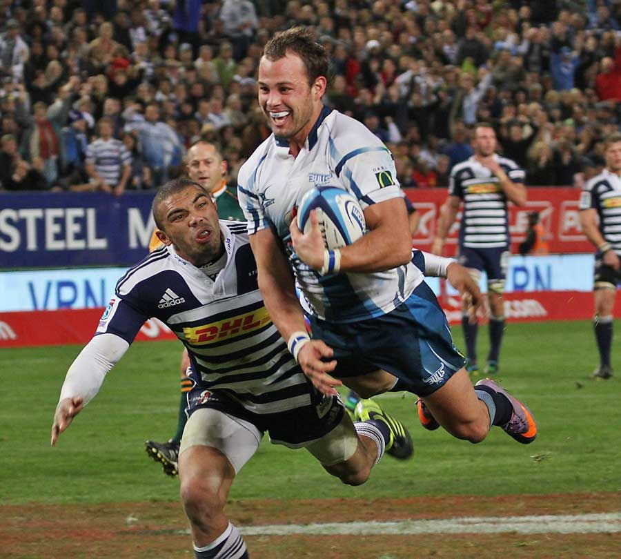 The Bulls' Francois Hougaard Evades The Stormers' Bryan
