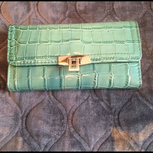 Sea green wallet that holds a checkbook Sea green wallet gently used in great condition comes from a smoke free home Unknown  Bags Wallets