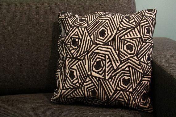 African emboidery cushion http://www.alittlemarket.com/textiles-et-tapis/fr_coussin_en_tissu_brode_motif_graphique_noir_et_blanc_-15771157.html