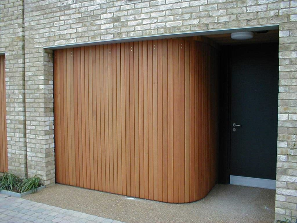 With Rundum Meir Custom Garage Doors You Can Create A Striking Statement That Blends Into And Enha Sliding Garage Doors Garage Door Design Rolling Garage Door