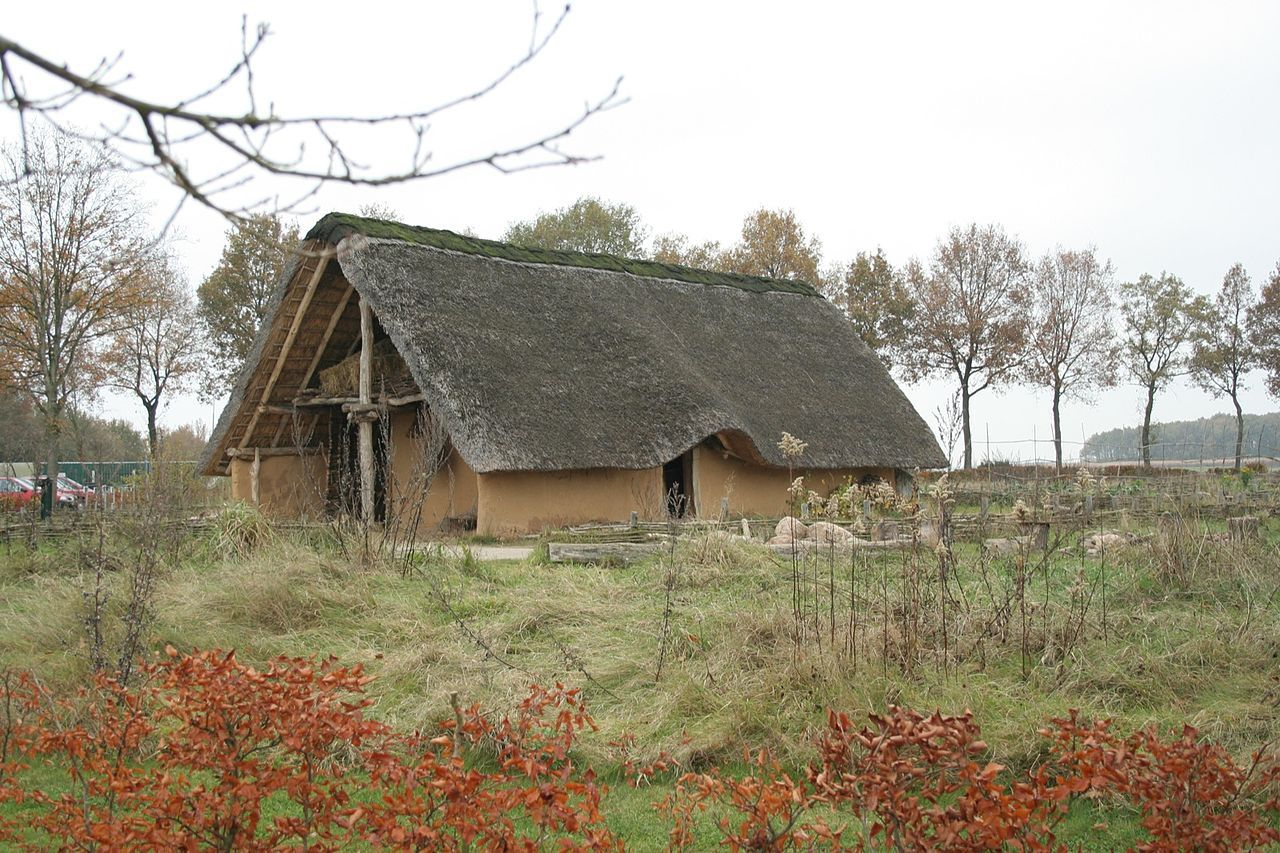 Borger, Netherlands | This is a reproduction of the kind of house that would have been around about 5,000 years ago in Drenthe. It is fully constructed of natural materials including mud, wood and a straw thatched roof.