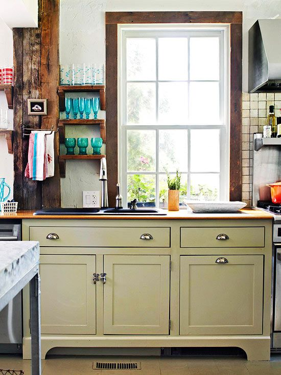 We are obsessed with the raw wood accents in this kitchen! Tour the rest of this colorful home: http://www.bhg.com/decorating/decorating-style/cottage/home-tour--incorporating-color/?socsrc=bhgpin071313rawwood=5