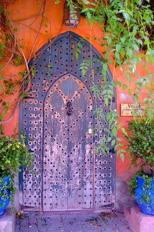 Mediterranean Front Door With Exterior Interlocking Pavers Exterior Tile Floors Purple Door Beautiful Doors Unique Doors