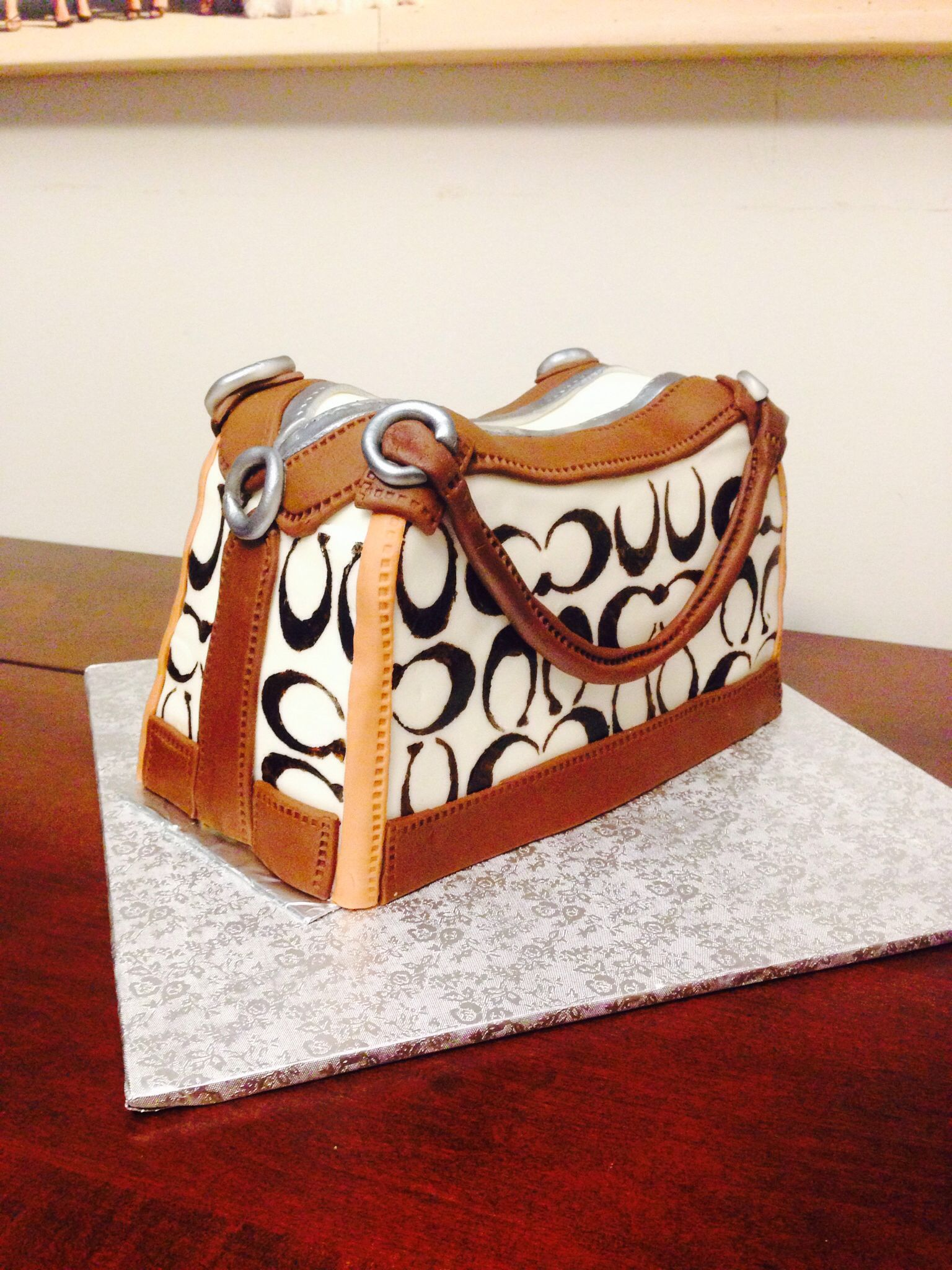 Coach purse cake. Gluten free chocolate fudge cake with vanilla buttercream and marshmallow fondant accents.