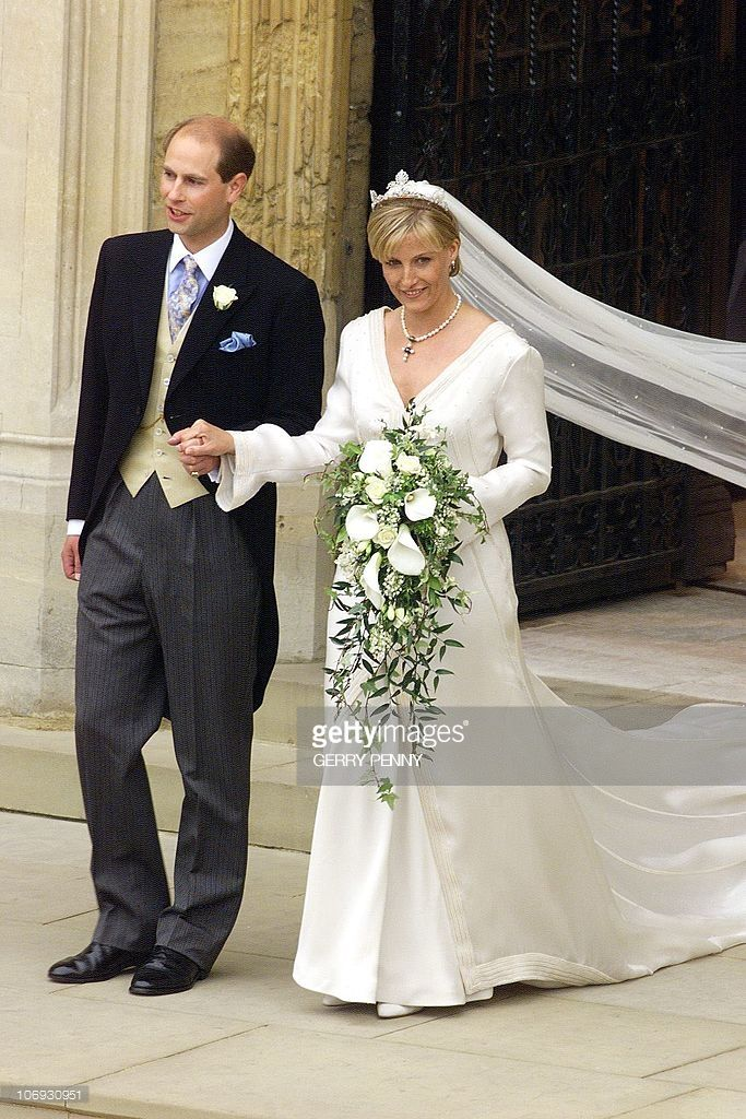 Prince Edward And Sophie Rhys Jones Leave St George S Chapel At Royal Wedding Gowns Royal Brides Famous Wedding Dresses