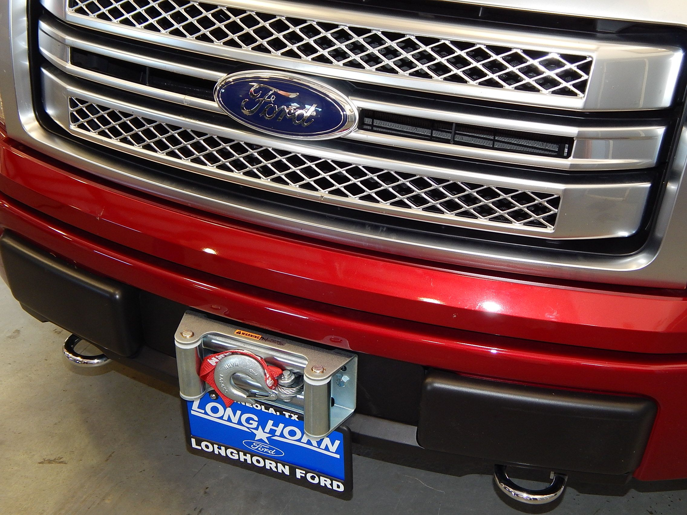 hidden winch installation on a ford f150 with a v8 engine the warn 9 5cti winch is hidden behind the front bumper leaving only the tow hook and roller  [ 2272 x 1704 Pixel ]