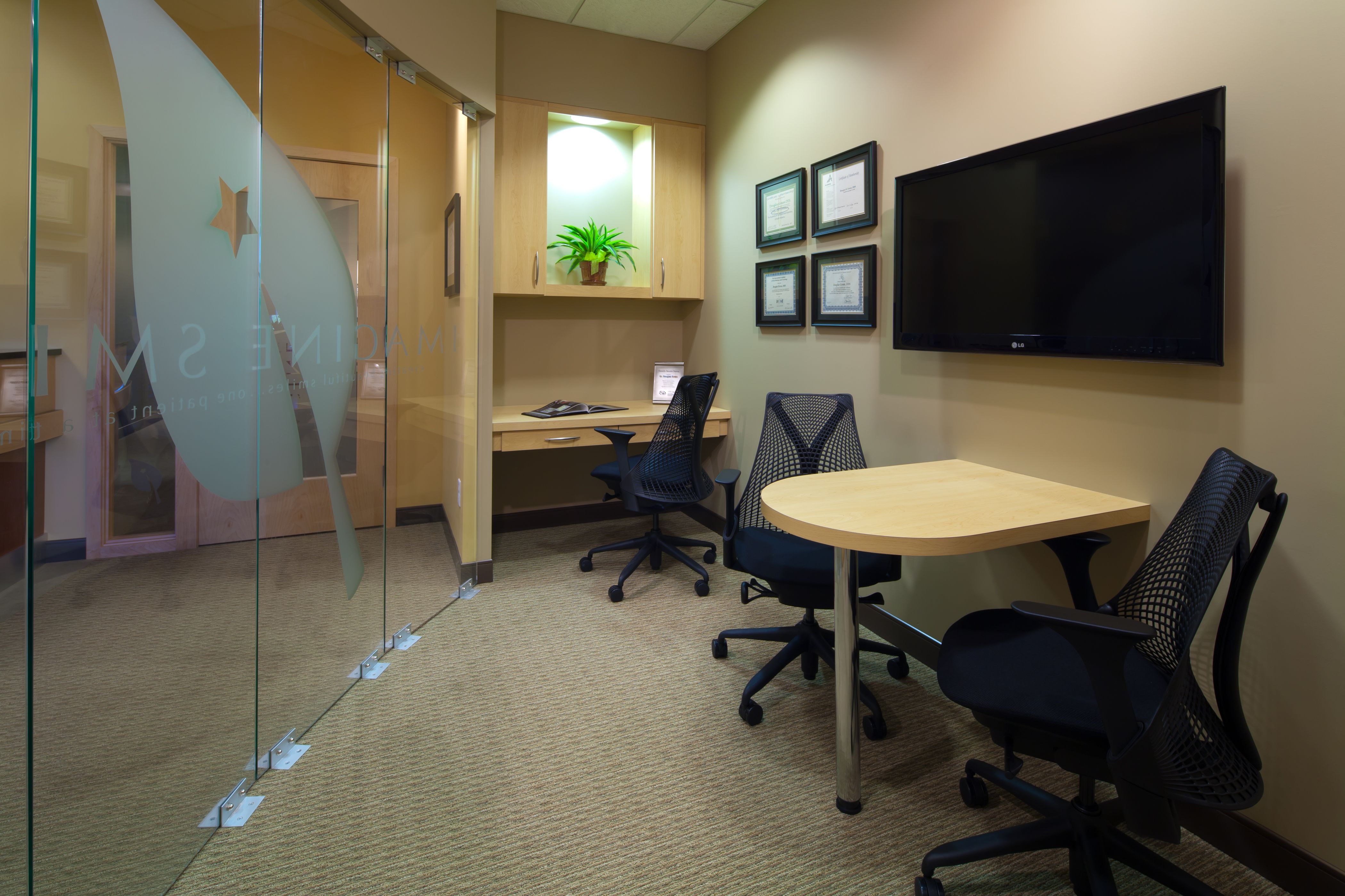 Consultation Room With Curved Glass Wall And Half Round