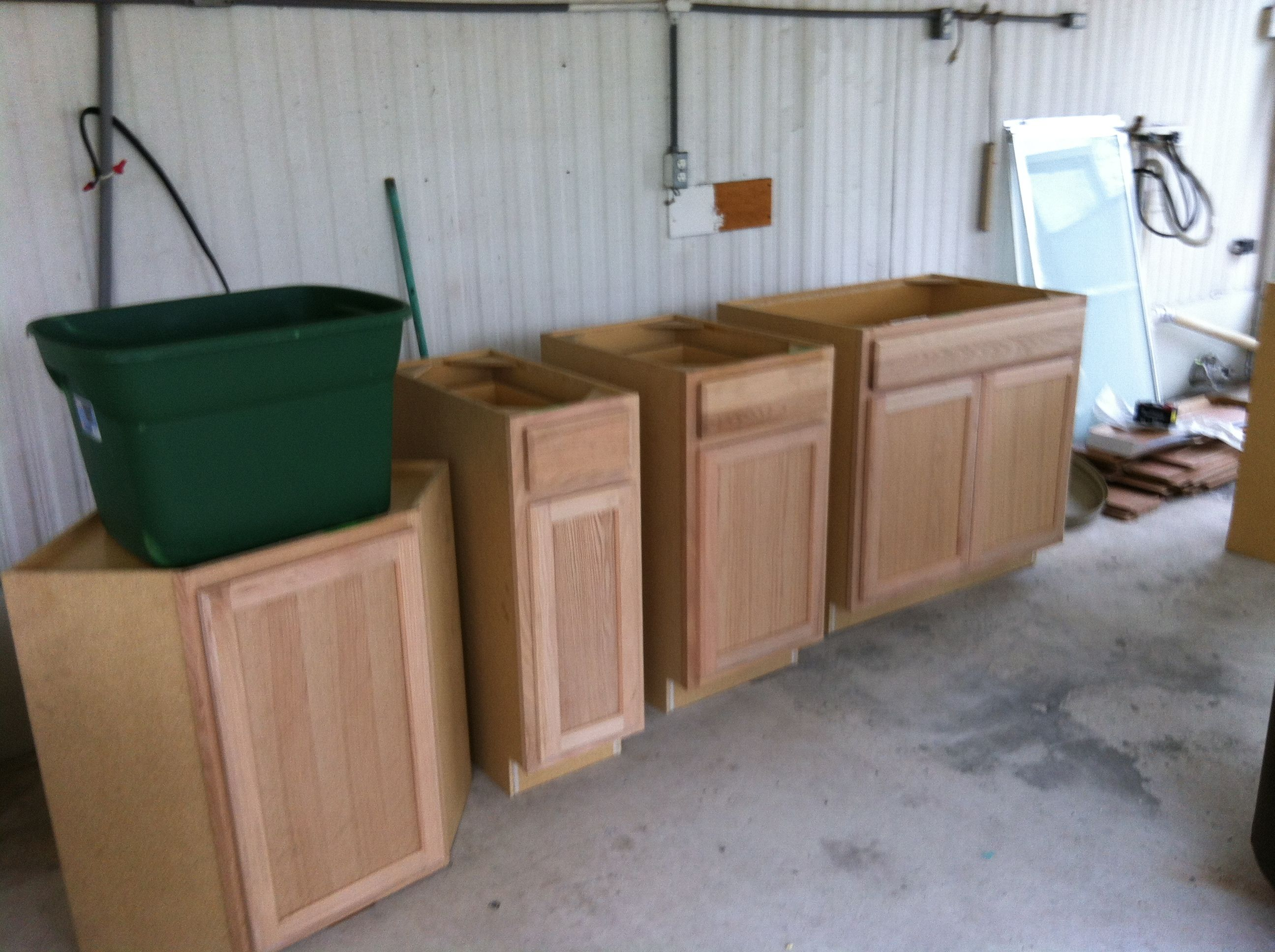 our unfinished kitchen cupboards awaiting their finish