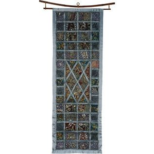 Give your wall a luxurious look with this glimmering wall hanging handcrafted using beads and embroidery stitched into grey satin. A simple geometric design, a stunning display.
