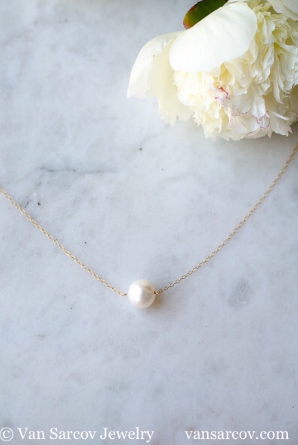 This beautifully handcrafted necklace comes with a single South Sea White Pearl in 14 K solid yellow gold, truly elegant jewelry you can enjoy for many years to come.